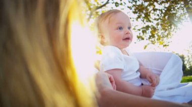Blonde Baby with Mom having fun in the park — Stock Video