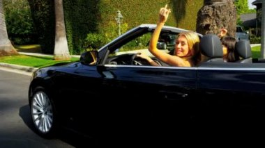 Pretty Girlfriends Enjoying Driving a Convertible — Stock Video