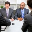 Young Executives Presenting Business Plan - Stock Photo