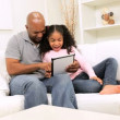 African American Father Daughter Home Wireless Tablet — Stock Video #23716331