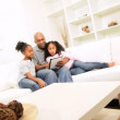 Royalty-Free Stock Vector Image: African American Father Children Home Wireless Technology