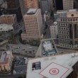 Stock Video: Aerial rooftop view of helipads, skyscrapers, LA, USA