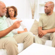 Stock Video: Senior Ethnic Couple with Adult Son Home