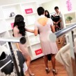 Female Friends Choosing Shoes Chic Boutique — Stock Video