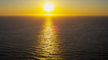 Aerial view of golden glow from setting sun, USA — Stock Video
