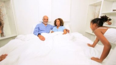 Ethnic Couple Granddaughters Relaxing Bed — Stock Video