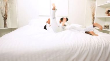 Ethnic Girls Jumping Home Bed — Vidéo
