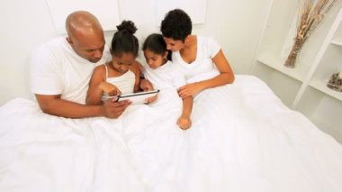 Ethnic Couple Children Using Wireless Tablet Bed — Stock Video