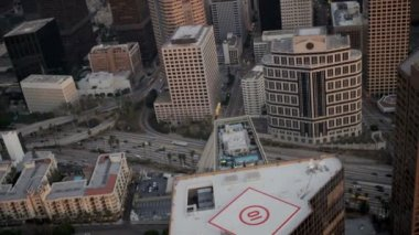Aerial rooftop view of helipads, skyscrapers, LA, USA — ストックビデオ