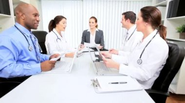 Multi Ethnic Medical Team Meeting with Financial Advisor — Stock Video