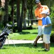 Father teaching son playing golf — Stock Video #49373067