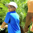 Father teaching son playing golf — Stock Video #49373093