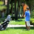 Father teaching son playing golf — Stock Video #49373351