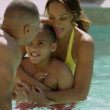 Family enjoying in outdoor pool — Stock Video #49374457