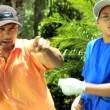 Father teaching son playing golf — Stock Video #49375341
