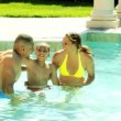 Family spending time in pool — Stock Video #49376343
