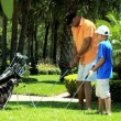 Father teaching son playing golf — Stock Video #49376779