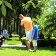 Father teaching son playing golf — Stock Video #49378069