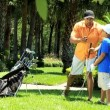 Father teaching son playing golf — Stock Video #49378891