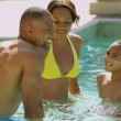 Family enjoying in outdoor pool — Stock Video