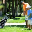Father teaching son playing golf — Stock Video #49379185