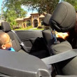 Couple with son in cabriolet — Stock Video #49379373