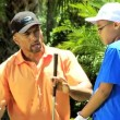 Father teaching son playing golf — Stock Video #49379617