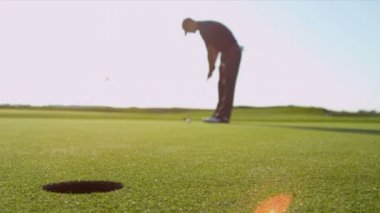 Golf professional using putter — Stock Video
