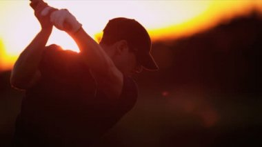 Golfer driving off at sunset — Stock Video
