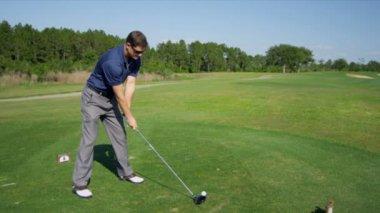 Professional golfer hitting golf ball — Stock Video