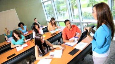 Teenagers working in modern classroom — Stock Video