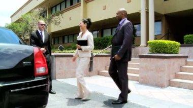 International banking colleagues being met — Stock Video