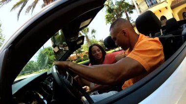 Couple driving in luxury cabriolet — Stock Video