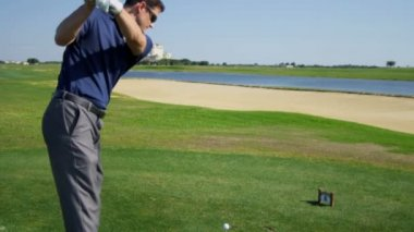 Professional golfer taking practice swing — Stock Video
