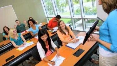 Teenagers working in classroom desks — Stock Video