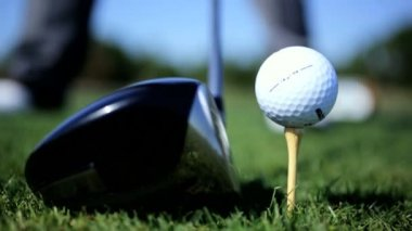 Golfer hitting golf ball — Stock Video
