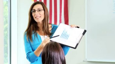 Female college tutor teaching students — Stock Video