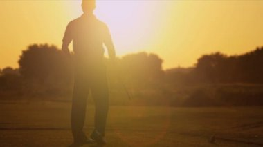 Golfer watching his ball — Stock Video