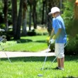 Father teaching son playing golf — Stock Video #49380273