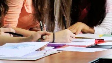 Teenage students working in classroom — Stock video