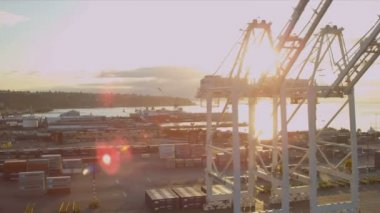 Aerial sun flare view of Container Shipping Port, Seattle — Vídeo Stock