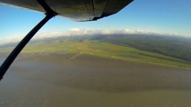 Aerial view of river melt waters swampland Wilderness landscape from light aircraft, Alaska, USA — Vidéo
