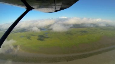 Aerial view of river melt waters swampland Wilderness landscape from light aircraft, Alaska, USA — Video Stock