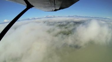 Aerial cloud view of distant mountain range remote Wilderness, light aircraft, Alaska, USA — Stock Video
