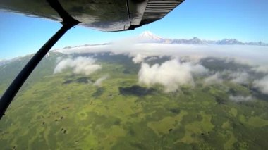 Aerial cloud view of distant Mt Redoubt Aleutian mountain range Alaskan Wilderness, Alaska, USA — Stock Video