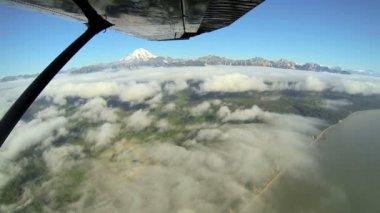 Aerial cloud view of distant Mt Redoubt Volcano Alaskan Wilderness light aircraft, Alaska, USA — Stock Video