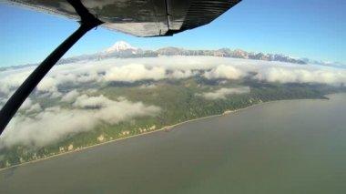 Aerial cloud view of distant Mt Redoubt Aleutian mountain range Alaskan Wilderness, Alaska, USA — Stock Video