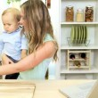 Young Caucasian Mom and Baby Boy at Home Kitchen — Stock Video #49574617
