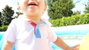 Caucasian baby boy playing at  plastic ball pool — Stock Video