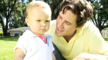 Proud Caucasian Father and Baby Son Enjoying Outing at Park — Wideo stockowe